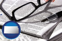 kansas map icon and a newspaper, with reading glasses and fountain pen