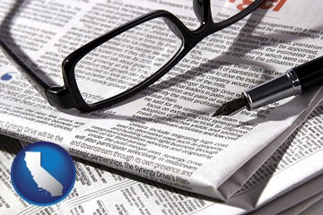 a newspaper, with reading glasses and fountain pen - with California icon