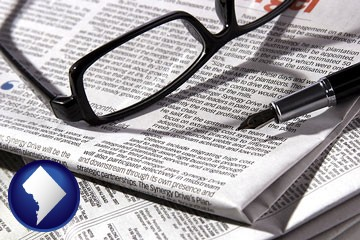 a newspaper, with reading glasses and fountain pen - with Washington, DC icon