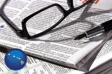 a newspaper, with reading glasses and fountain pen - with Hawaii icon