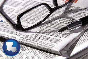 a newspaper, with reading glasses and fountain pen - with Louisiana icon