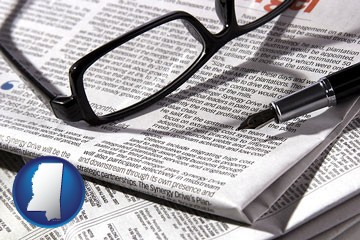 a newspaper, with reading glasses and fountain pen - with Mississippi icon