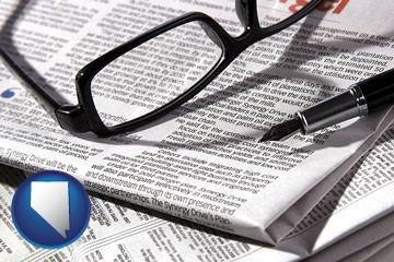 a newspaper, with reading glasses and fountain pen - with Nevada icon