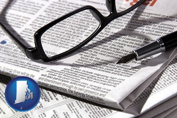 a newspaper, with reading glasses and fountain pen - with Rhode Island icon