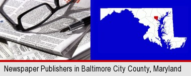 a newspaper, with reading glasses and fountain pen; Baltimore City highlighted in red on a map