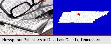 a newspaper, with reading glasses and fountain pen; Davidson County highlighted in red on a map