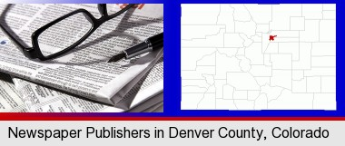 a newspaper, with reading glasses and fountain pen; Denver County highlighted in red on a map