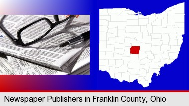 a newspaper, with reading glasses and fountain pen; Franklin County highlighted in red on a map
