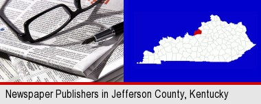 a newspaper, with reading glasses and fountain pen; Jefferson County highlighted in red on a map