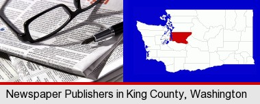 a newspaper, with reading glasses and fountain pen; King County highlighted in red on a map