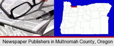 a newspaper, with reading glasses and fountain pen; Multnomah County highlighted in red on a map