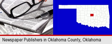 a newspaper, with reading glasses and fountain pen; Oklahoma County highlighted in red on a map