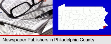 a newspaper, with reading glasses and fountain pen; Philadelphia County highlighted in red on a map