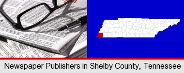 a newspaper, with reading glasses and fountain pen; Shelby County highlighted in red on a map