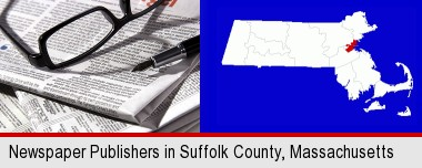 a newspaper, with reading glasses and fountain pen; Suffolk County highlighted in red on a map